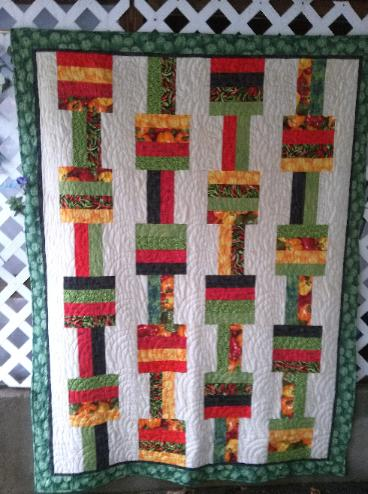 Salsa Fiesta - chili, red, green, and yellow peppers, cactus, and fabric with words - Lap or Wall size - 57 x 74, $250.
